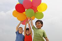 Three children holding balloons. - Yukmin