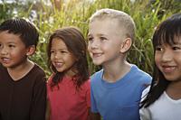 Close-up of four children smiling. - Yukmin