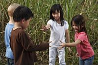 Four children playing outside. - Yukmin