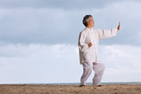 Older woman doing tai chi. - Yukmin