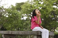 Young girl eating ice cream. - Yukmin