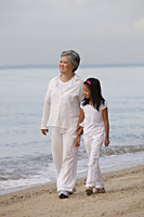 Older woman walking with young girl. - Yukmin