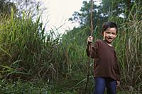 Boy holding stick. - Yukmin