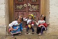 Tibetan girls posing at the door of Songzanlin Temple, shangri la, shangrila, China - OTHK