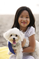 Young girl hugging dog. - Yukmin