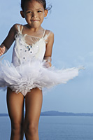 Girl jumping in air wearing tutu. - Yukmin