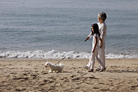 Older woman walking dog with young girl. - Yukmin