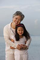 Grandma hugging little girl. - Yukmin