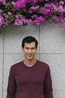 man in sweater smiling at camera - Yukmin