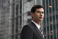 business man in a suit looking away - Yukmin
