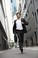 businessman running down street - Yukmin