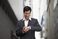 businessman looking at watch - Yukmin