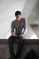 man listening to music with earphones - Yukmin