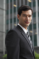 business man in a suit looking at camera - Yukmin
