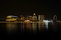 Night shot of Singapore skyline with Esplanade and Singapore Flyer - Nugene Chiang