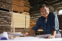 Mature man working in wood shop. - Nugene Chiang