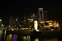Night view of The Merlion and Shenton Way, Singapore - Nugene Chiang