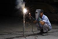 Mature man welding. - Nugene Chiang