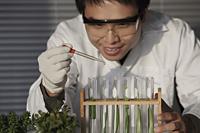 Scientist testing plants in test tube - Yukmin