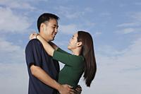Young couple hugging outside - Yukmin