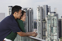 Young couple hugging and looking at view - Yukmin