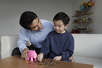 Father talking to young son about finances - Yukmin