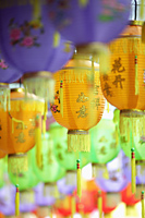 Colorful Chinese lanterns hanging in a row - Yukmin