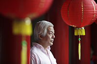 Profile of older man looking at Chinese temple - Yukmin