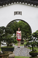 Young woman standing in Chinese garden - Yukmin