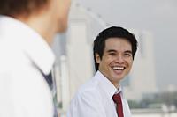 Business man laughing at another man - Yukmin