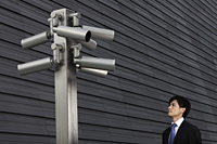 Man looking at surveillance cameras - Yukmin