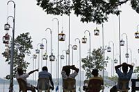 Men listening to birds at Bird Park, Singapore - Yukmin