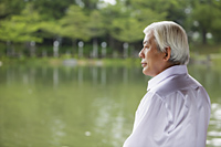 Profile of older man looking at lake - Yukmin