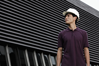 Chinese man with construction hat in front of building - Yukmin