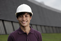 Chinese man wearing construction hat smiling - Yukmin