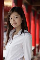 Head shot of Chinese woman looking at camera - Yukmin
