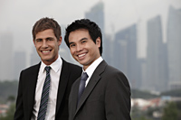 Chinese man and Caucasian man standing in front of buildings - Yukmin