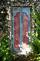 carved wooden doors in stone wall - Alex Mares-Manton
