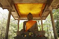 Stone statue of Buddha wearing orange sash. Angkor Wat - Alex Mares-Manton