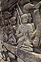 carved stone images on the all of Angkor Wat, Combodia - Alex Mares-Manton