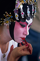 China,Hong Kong,Portrait of Chinese Opera Actress Applying Make-up - Travelasia
