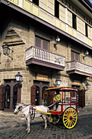 Philippines,Manila,Calesa or Horse-drawn Carriage and Spanish Colonial Building in the Intramuros Historical District - Travelasia