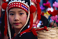 Thailand,Chiang Rai,Akha Hilltribe Girl Wearing Traditional Silver Headpiece - Travelasia