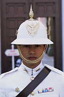 Thailand,Bangkok,Wat Phra Kaeo,Guard at the Royal Palace - Travelasia