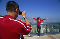 China,Hong Kong,Couple taking photos at Victoria Peak - Travelasia
