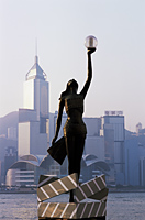 China,Hong Kong,Kowloon,Tsim Sha Tsui,Avenue of the Stars,Bronze Statue with City Skyline in the Background - Travelasia