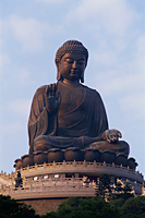 China,Hong Kong,Lantau,The Worlds Largest Outdoor Seated Bronze Buddha Statue at the Po Lin Monastery - Travelasia