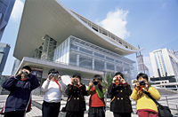 China,Shanghai,Children Taking Photoes in front of Shanghai Grand Theatre in People's Square - Travelasia