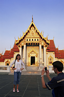 Thailand,Bangkok,Tourist Couple Taking Photos in Wat Po - Travelasia