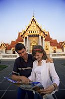 Thailand,Bangkok,Wat Benchamabophit,Tourist Couple in the Marble Temple - Travelasia
